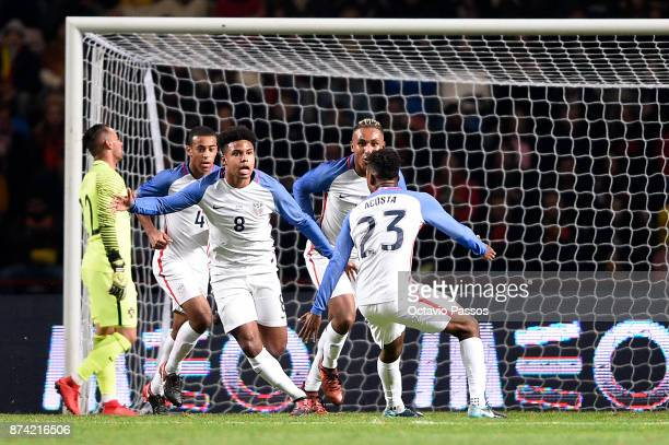 Weston McKennie of USA celebrates after scoring the first goal during the International Friendly match between Portugal and USA at Estadio Municipal...