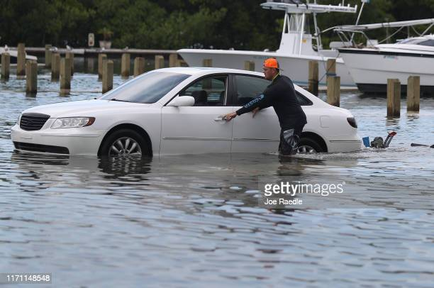 Weston Rice drives through a flooded parking lot as he prepares to drop his jet ski into the water at the Haulover Marine Center before the arrival...