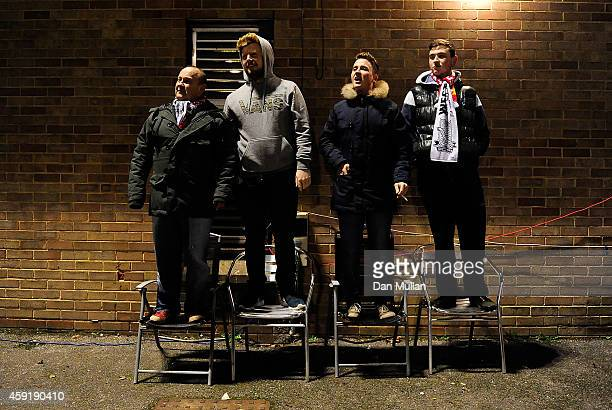 WestonSuperMare supporters stand on chairs to get a view of the pitch during the FA Cup First Round match between WestonSuperMare and Doncaster...