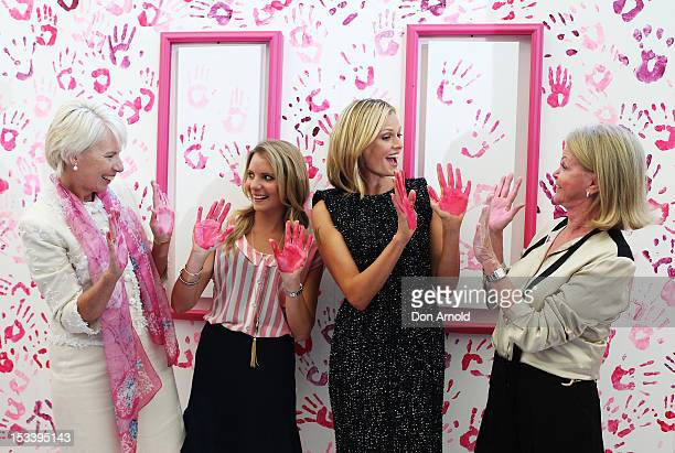 Westpac CEO Gail Kelly Anne Kelly National Breat Cancer Patron Sarah Murdoch and Carol O'Hare pose after laying their painted hand prints on a...
