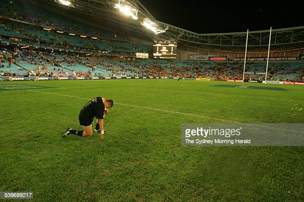 Wests Tigers Captain Scott Prince kneels down and cries in the middle of the field after his team won the rugby league grand final against the North...