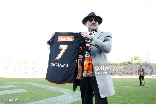 Wests Tigers Chairman Lee Hagipantelis holds up the number seven jersey as a tribute to the late Tommy Tommy Raudonikis during the round five NRL...