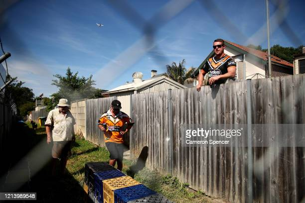 Westst Tigers fans look over their back fence to Leichhardt Oval during the round 2 NRL match between the Wests Tigers and the Newcastle Knights at...