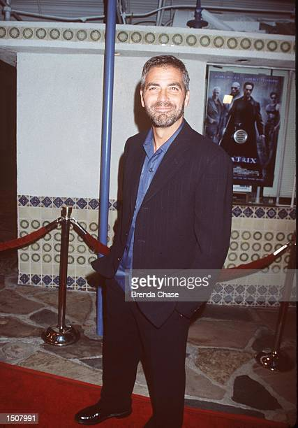 03/24/99 Westwood CA George Clooney arrives at the world premiere showing of the new film The Matrix at the Mann's Village Theatre Photo Brenda...