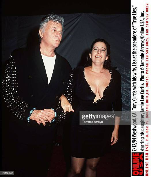 "Westwood, CA. Tony Curtis with his wife, Lisa Deutsch at the premiere of ""True Lies,"" starring his daughter, Jamie Lee Curtis."