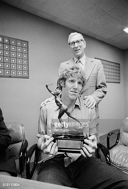 UCLA's Bill Walton holds the Sullivan award as his coach of four years John Wooden beams his approval following the announcement that the college...