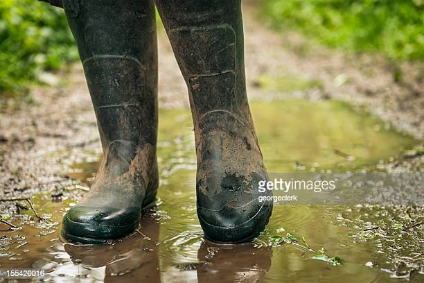 wet and muddy country walk - dirty feet stock pictures, royalty-free photos & images