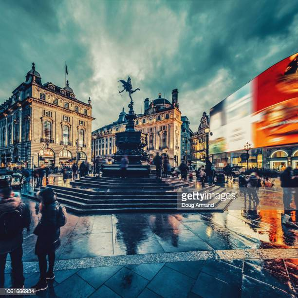 a wet and rainy piccadilly circus, london, uk - piccadilly stock pictures, royalty-free photos & images