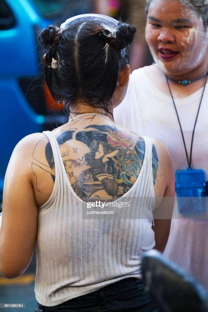 Wet Back Of Thai Girl With Tattoo Stock Photo