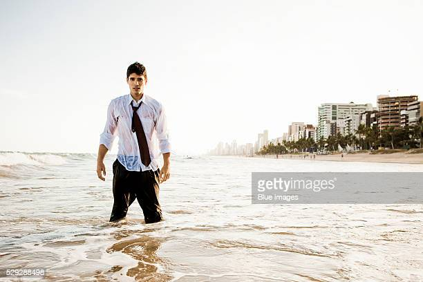 wet businessman standing in ocean - wading stock pictures, royalty-free photos & images