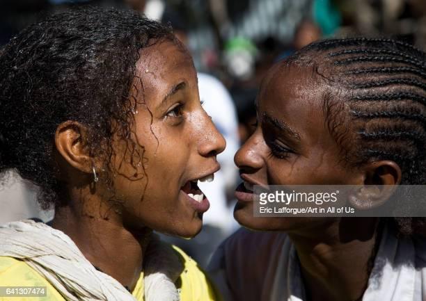Wet ethiopian girls after taking the holy bath during Timkat epiphany festival on January 19 2017 in Lalibela Ethiopia