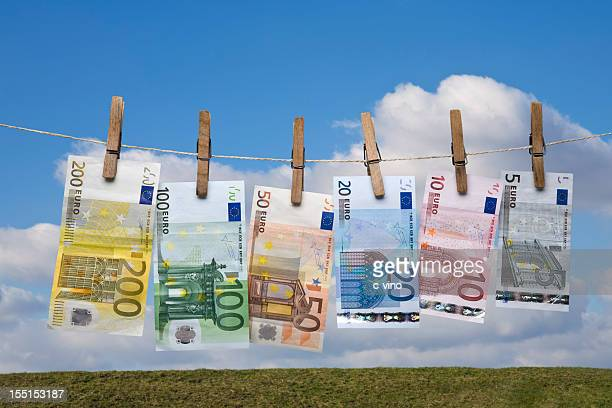Wet Euro banknotes hanging on a clothes line