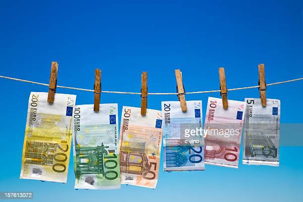 wet euro banknotes hanging on a clothesline - five euro banknote stock photos and pictures