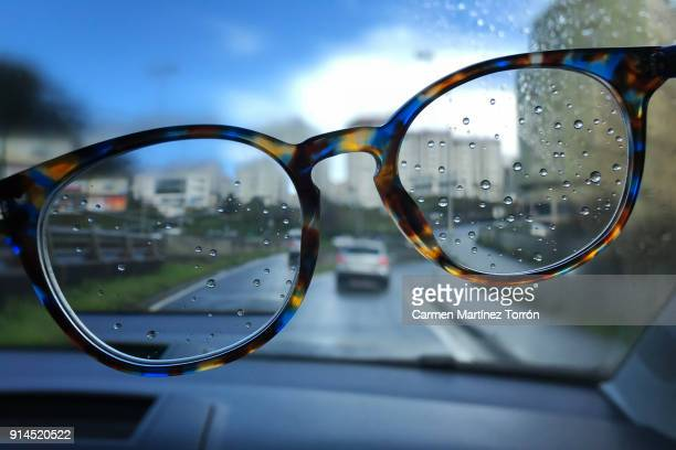 wet eye glasses in the rain - myopia stock photos and pictures