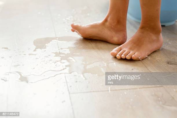 wet floor - beautiful male feet stock photos and pictures