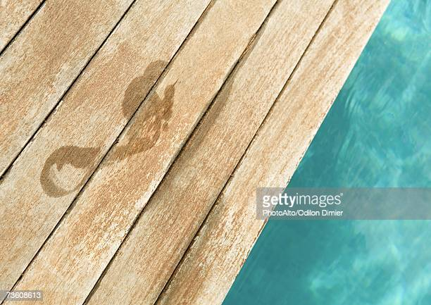 wet footprint by edge of pool - poolside stock pictures, royalty-free photos & images