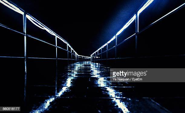 Wet Illuminated Road At Night