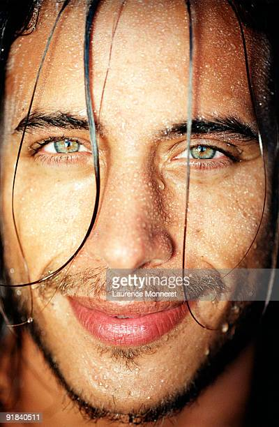 wet man smiling - green eyes stock pictures, royalty-free photos & images