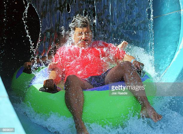 Wet ''N'' Wild Waterworld provided relief from the heat July 20 as a patron got doused as he tubes through The Amazon water ride in Anthony Texas A...