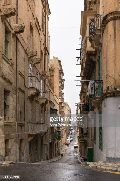 Wet narrow street in historical city of Valletta,Malta