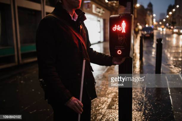 wet night in the city centre - blindness stock pictures, royalty-free photos & images
