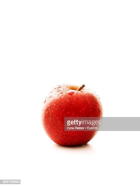 Wet Red Apple Over White Background