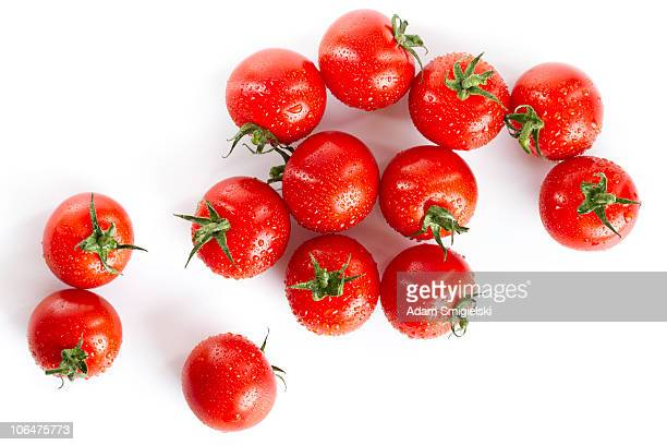 wet red cherry tomatoes isolated on white