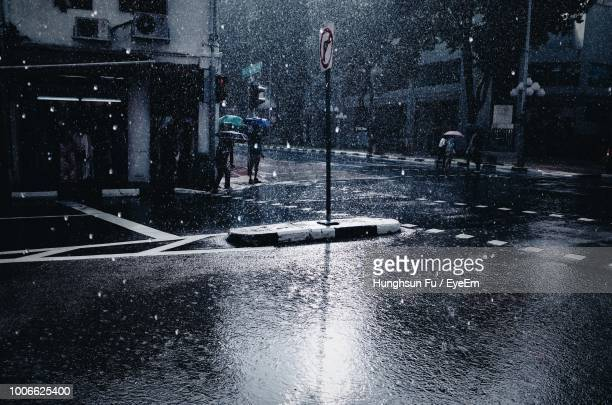 wet road in city during winter - rain ストックフォトと画像