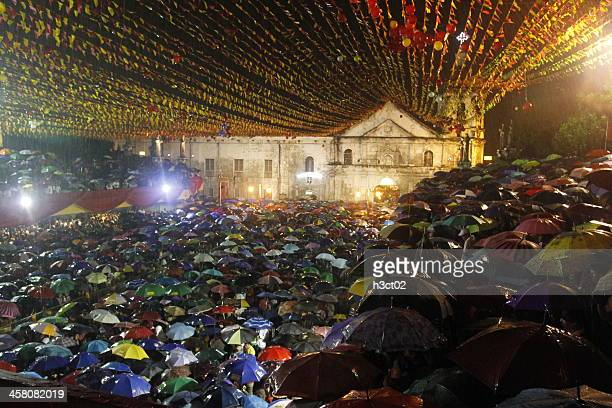 wet sinulog mass - sinulog festival stock photos and pictures