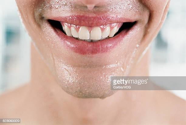 a wet smile - damp lips stock photos and pictures