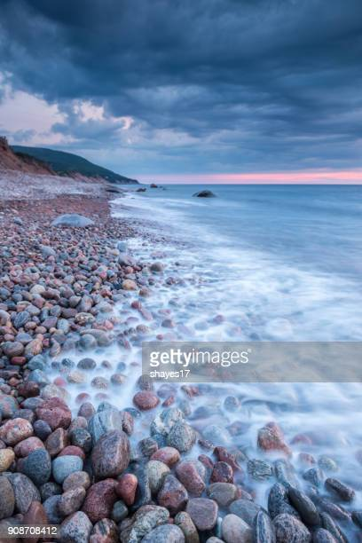 wet stone shore - cape breton island stock pictures, royalty-free photos & images