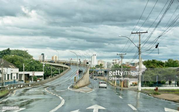 wet streets - crmacedonio stock photos and pictures