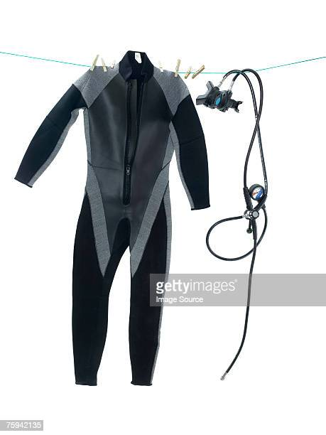 Wet suit and diving equipment on washing line