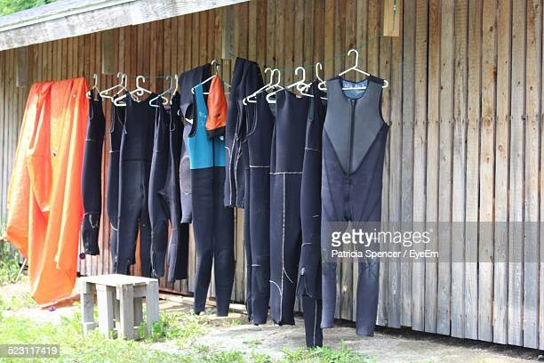 Wet Suits Hanging On Rope