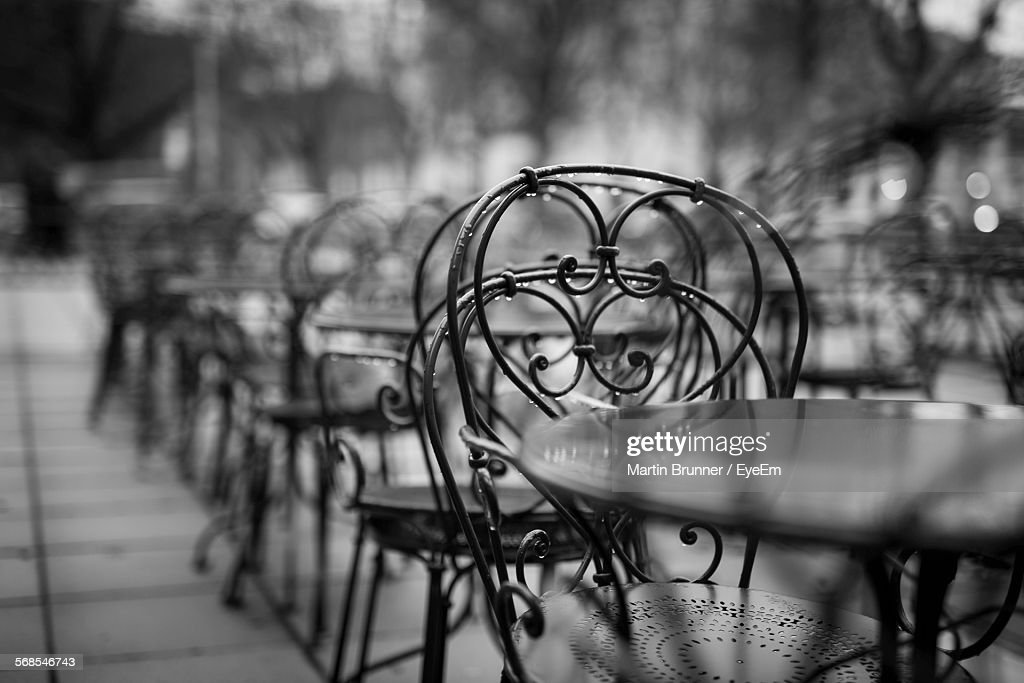 Wet Tables And Chairs Of Sidewalk Cafe In Rain : Stock Photo