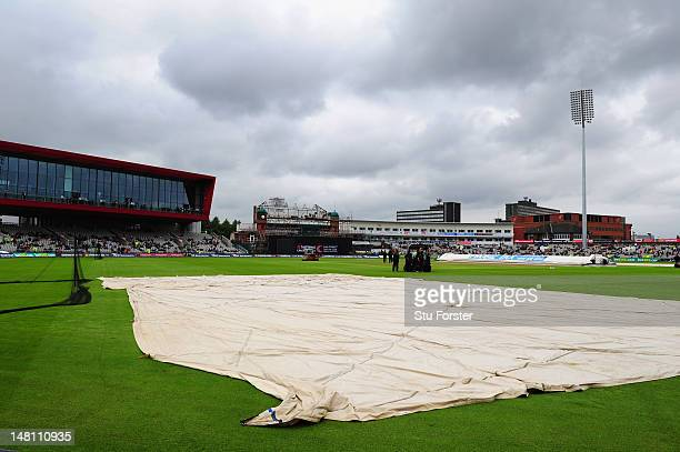 Wet weather delays the start of the 5th NatWest One Day International between England and Australia at Old Trafford on July 10, 2012 in Manchester,...