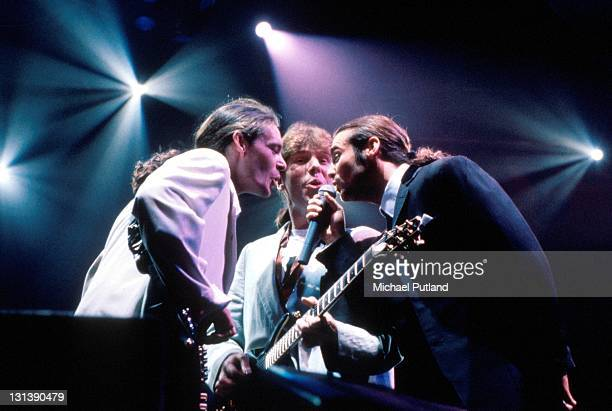 Wet Wet Wet perform on stage London LR Graeme Clark Graeme Duffin Marti Pellow