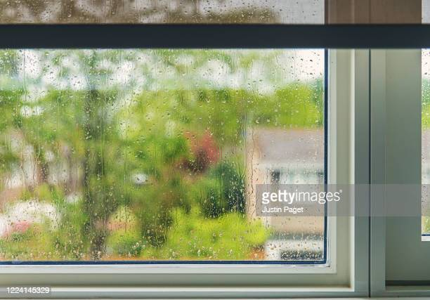 a wet window - window stock pictures, royalty-free photos & images