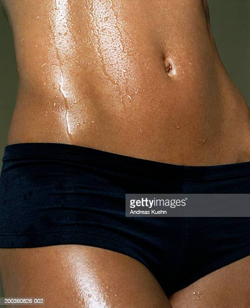 wet young woman, mid section - wet knickers stock pictures, royalty-free photos & images