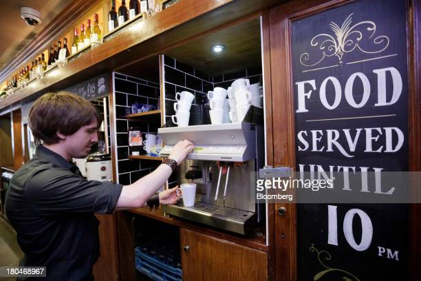 Wetherspoon Plc employee uses a coffee machine to make a hot drink for a customer inside one of the company's pubs in London UK on Friday Sept 13...