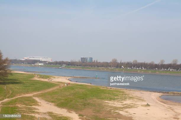 wetland and people at rhine opposite to messe duesseldorf - messe düsseldorf stock pictures, royalty-free photos & images