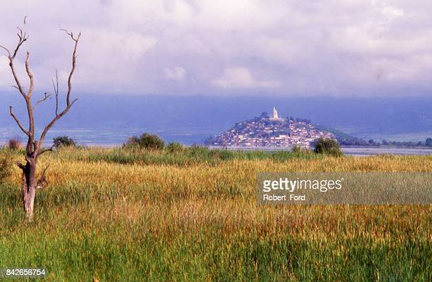 wetlands and bullrushes along Lake Patzcuaro Mexico seen from mainland with Janitzio Island in distance