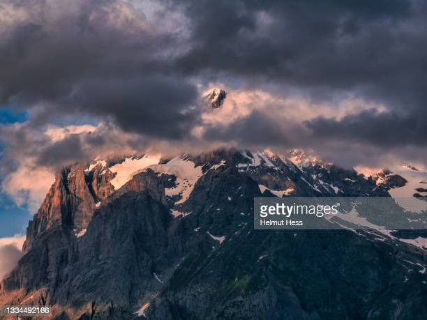 wetterhorn near grindelwald in the evening light - formal glove stock pictures, royalty-free photos & images