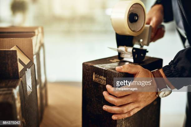 we've got your package sealed, safe and secure - tape dispenser stock photos and pictures