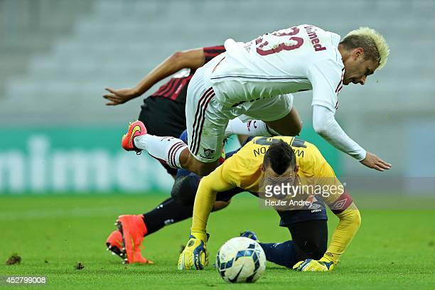 Weverton of AtleticoPR competes for the ball with Rafael Sobis of Fluminense during the match between AtleticoPR and Fluminense for the Brazilian...