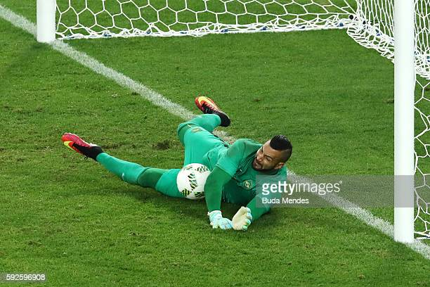 Weverton the Brazil goalkeeper saves the penalty taken by Nils Petersen of Germany during the penalty shoot out in the Men's Football Final between...