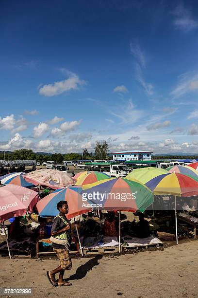 Wewak food market with stalls shaded by giant umbrellas Wewak Sepik River East Sepik Province Papua New Guinea