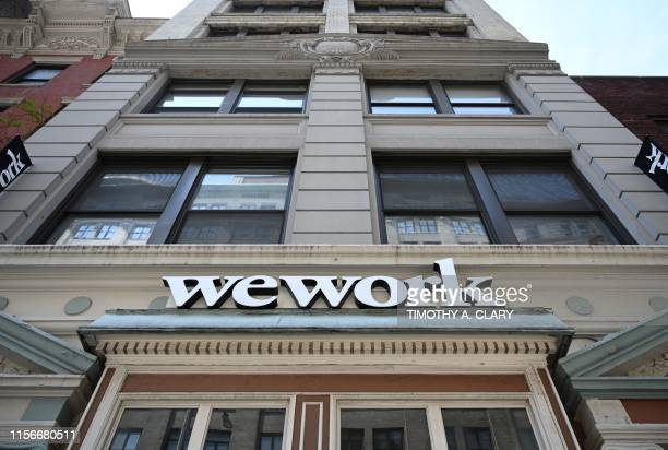 WeWork office is seen in New York City on July 19, 2019. - With its free coffee, couches and glass partitions, shared workspace startup WeWork has...