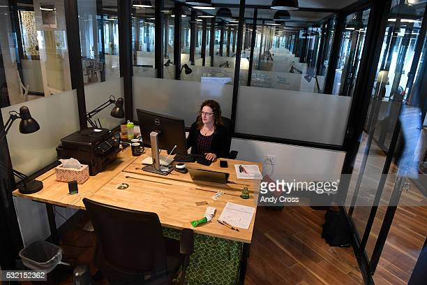 WeWork Union Station member Emilie Baratta a Principal for the Turnbuckle Development company works in her office space at WeWork May 18 2016