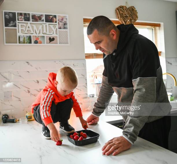 Wexford Ireland 17 June 2020 Professional boxer and member of An Garda Síochána Niall Kennedy with his son MJ at their home in Gorey Wexford before...